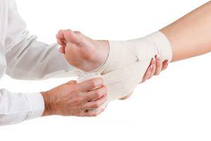 Flexible elastic supportive orthopedic bandage isolated on white background, compression stabilizer ankle.